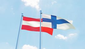 Two waving flags. Austria and Finland, two flags waving against blue sky. 3d image Royalty Free Stock Photo