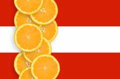 Austria flag and citrus fruit slices vertical row royalty free stock images