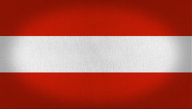 Austria flag. Flag composed by three horizontal lines, two in the top and in the bottom in red, and a white one in the middle of it, fabric texture background Royalty Free Stock Photos