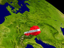 Austria with flag on Earth. Map of Austria with embedded flag on planet surface. 3D illustration. Elements of this image furnished by NASA Royalty Free Stock Images