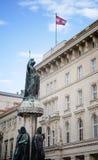 Austria flag with statue in the downtowan Vienna, Austria Stock Photos