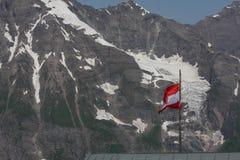 Austria flag waving on Grossglockner Hochalpenstrasse in Austria Stock Image