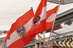 Austria flags. Three Austrian flags with eagles Stock Photo