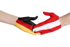 Austria and germany shaking hands Royalty Free Stock Photography