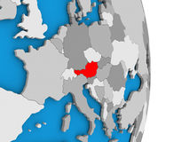 Austria on globe. Map of Austria in red on globe. 3D illustration Royalty Free Stock Photo