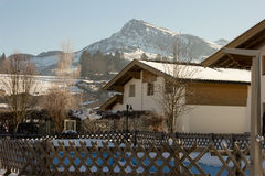 Austria kitzbuhel. Landscape of Alps with a wooden cottage Royalty Free Stock Photos