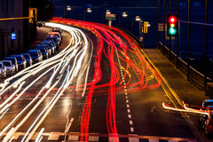 Austria, linz. lights of moving cars. Traffic in city at night, symbol of traffic, congestion, air pollution royalty free stock photos
