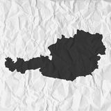 Austria map in black on a background crumpled paper. Austria  map in black on a background crumpled paper Stock Image