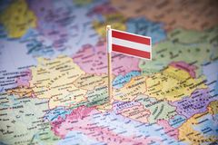 Austria marked with a flag on the map.  stock photo