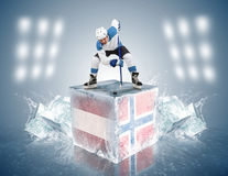 Austria - Norway game.  Face-off player on the ice cube Stock Photo