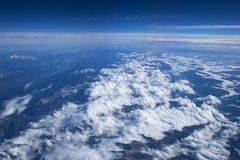AUSTRIA - October 2016: The alps as seen from an airplane, plane view of mountains and clouds Stock Photo