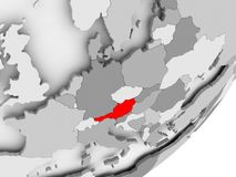 Austria in red on grey map. Illustration of Austria highlighted in red on grey globe. 3D illustration Stock Photography