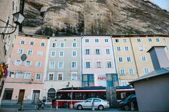 Austria, Salzburg, January 1, 2017: Traditional Austrian multicolored houses in the rock in Salzburg. Austrian Royalty Free Stock Images