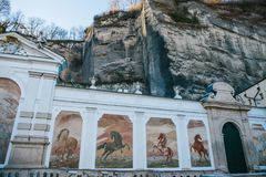 Austria, Salzburg - 01. 01. 2017. Murals with horses on square fountain stock photography
