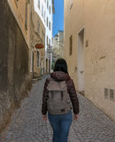 Austria. Salzburg. Woman tourist walking in the street. Of the old town Royalty Free Stock Image