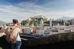 Austria. Salzburg. A young tourist girl takes pictures stock photos