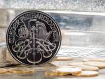 Austria Silver Coin with silver bars & gold coins. Austria Silver Coin with silver bars & gold coin royalty free stock photography