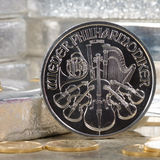 Austria Silver Coin with silver bars & gold coins Royalty Free Stock Image