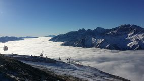 Above the clouds. Skiing in Austria on a bluebird day above the clouds stock images