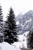Austria, snowing on the Pass Thurn route. Landscape full of now. It is snowing again, but the route is clean in perfect maintenance royalty free stock photography
