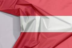 Austria tkaniny flaga zagniecenie z biel przestrzenią i krepa zdjęcia royalty free