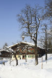 Austria, Tyrol. Farmstead in traditional architecture covered with snow stock photography
