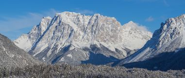 Austria, Tyrolean Alps. Road to Fern pass. Wonderful landscape just after a snow fall. The Zugspitze peak on the back Royalty Free Stock Photography
