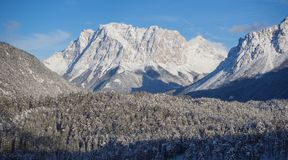 Austria, Tyrolean Alps. Road to Fern pass. Wonderful landscape just after a snow fall. The Zugspitze peak on the back Stock Photos