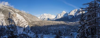 Austria, Tyrolean Alps. Road to Fern pass. Wonderful landscape just after a snow fall. The Zugspitze peak on the back Royalty Free Stock Image