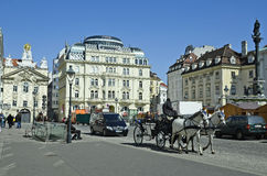 Austria, Vienna. Vienna, Austria - March 27th 2016: Unidentified tourists by sightseeing in traditional horse drawn coach named Fiaker on Am Hof square, a Stock Photo