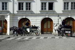 Austria, Vienna. Vienna, Austria - March 27th 2016: Unidentified tourists by sightseeing in traditional horse drawn coach named Fiaker, a preferred tourist Stock Image
