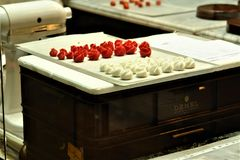 Austria, Vienna - May 2011: Cafe Demel in the city center, workshop for preparing Viennese sweets, handmade white and red candy. stock image