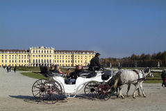 Austria, Vienna. Vienna, Austria - October 31st 2010: Unidentified tourists in horse drawn coach named Fiaker - on sightseeing in Schoenbrunn Royalty Free Stock Photos