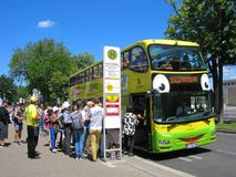 Tourists in Vienna, touristic urban bus, crowd of people on stop. Austria, Vienna. Tourists in the city on stop of touristic urban bus. Crowd of people wait to royalty free stock image
