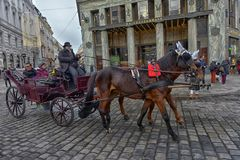 Traditional travel on a trip with horse carriage ride in the center of Vienna. Austria, Vienna 30,12,2017 Traditional travel on a trip with horse carriage ride royalty free stock photography