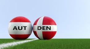 austria vs Belgium Dani mecz piłkarski - piłek nożnych piłki w Austria i Dani krajowych kolorach na boisko do piłki nożnej Obrazy Stock