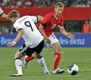 Austria vs. Germany. VIENNA, AUSTRIA - JUNE 3 Andre Schuerrle (#9, Germany) and Daniel Royer (#18, Austria) fight for the ball during the EURO 2012 soccer game stock photo