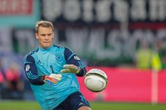 Austria vs. Germany. VIENNA,  AUSTRIA - SEPTEMBER 11 Manuel Neuer (#1 Germany) catches the ball during the WC qualifier soccer game on September 11, 2012 in Royalty Free Stock Images
