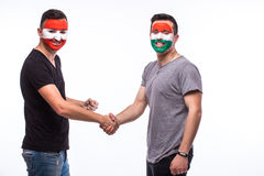 Austria vs Hungary handshake of equal game on white background. Stock Images