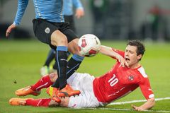 Austria vs. Uruguay. KLAGENFURT, AUSTRIA - MARCH 05, 2014: Diego God�n (#3 Uruguay) and Zlatko Junuzovic (#10 Austria) fight for the ball in a friendly stock images