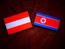 Austriak flaga z koreańczyk z korei północnej flaga na drzewnym fiszorku Obraz Stock