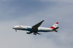 Austrian Airlines Boeing 777 descending for landing at JFK International Airport in New York Royalty Free Stock Photography