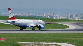 Austrian Airlines jet doing taxi on runway. Austrian Airlines plane taxiing on airport runway stock video footage