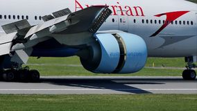 Austrian Airlines jet doing taxi on runway, close-up view. Austrian Airlines plane taxiing on airport runway stock footage