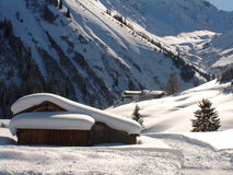 Austrian Alpine winter scene. Snow covered roof in Austrian Tyrol Royalty Free Stock Photo