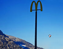 Austrian Alps,balloning over the mountains and Mcdonald advertis Stock Images