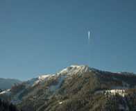 Austrian Alps, blue sky and an airplane Stock Image