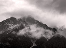 Austrian Alps in the mist. Austrian alps in the fog at night, black and white photo Royalty Free Stock Image