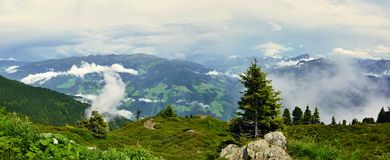 Austrian Alps-panoramic outlook on Alps from Zillertaler road. Austrian Alps-panoramic outlook on Alps with fog in valleys from Zillertaler road,with mountain Royalty Free Stock Photography