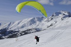 Austrian Alps: Paragliding in Wintertime. Austrian Alps: Paragliding from Skiregion Zettersfeld above the City of Lienz in East-Tirol Stock Photography